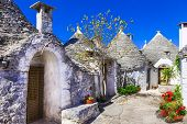 stock photo of conic  - Unique Trulli houses with conical roofs in Alberobello - JPG