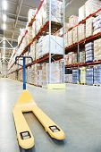 stock photo of pallet  - Manual forklift pallet stacker truck equipment at warehouse panorama - JPG