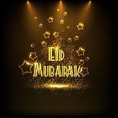 stock photo of eid festival celebration  - Creative golden text Eid Mubarak shining in spotlight on stars decorated brown background for Muslim community festival - JPG