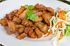 foto of pork belly  - Fried pork belly with fish sauce a Thai cuisine - JPG
