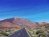 pic of canary-islands  - A long lonesome highway leads toward the volcano El Tiede near Tenerife Canary Islands - JPG