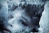 Face in ice, in blue tones