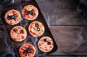The Idea Of A Festive Meal For Halloween: Mini Pizza With Spiders, Mummy And Spiderweb, Copy Space,  poster
