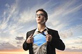 stock photo of superman  - Businessman with superhero suit under his skirt - JPG