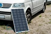 Natural Energy Car And Solar Panel. Example Of Using A Solar Panel In Nature Picnic. poster