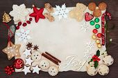 Christmas background border with joy sign including tree decorations, biscuits, cakes, chocolates an poster