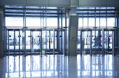 picture of windows doors  - plenty of glass doors and reflections on the floor - JPG