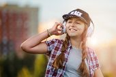 Young Girl Listening To Music On Headphones, Urban Street Style, Outdoor Street Style Hipster Dj Wom poster