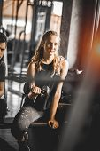 Fit Beautiful Young Woman Caucasian Attractive Fitness Woman Exercise With Dumbbell By Trainer In Gy poster