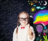 Creativity Education Concept. Smiling Little Girl Student Having Fun And Showing Thumb Up On Blackbo poster