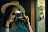 Girl Traveler Taking Photo Through Trains Window. poster