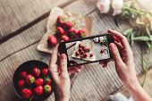 Girls Hands Taking Photo Of Breakfast With Strawberries By Smartphone. Healthy Breakfast, Clean Eat poster