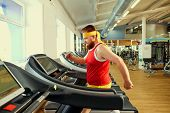 A Funny Fat Man  Doing Exercises In The Gym. poster