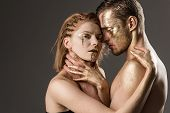 Passionate Couple Embracing, Boy And Girl. Passionate Couple With Golden Paint On Body, Copy Space poster