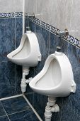 stock photo of pissoire  - Two white pissoirs from a public restroom - JPG