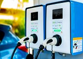 Electric Car Charging Station. Plug For Vehicle With Electric Motor. Coin-operated Charging Station. poster