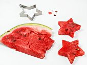Pieces Of Ripe Juicy Watermelon Carved In The Form Of Stars And A Whole Piece Of Watermelon On A Whi poster