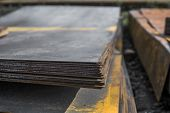 Steel Sheets Deposited In Stacks In Packs At The Warehouse Of Metal Products. Weathered Metals Sheet poster