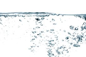 pic of boiling water  - Some Air bubbles isolated over white background - JPG