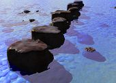 foto of stepping stones  - Row Of Stepping Stones In A Blue Ocean River Scene - JPG