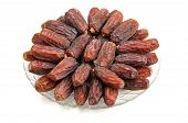foto of circumcision  - plate of fresh dates lined up on a white background - JPG