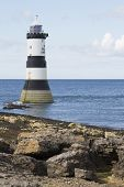 stock photo of anglesey  - Lighthouse at Penmon Point Anglesey North Wales - JPG