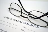 picture of self assessment  - Close up of reading glasses  on Employee self evaluation - JPG