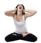 Young Woman Sitting In A Pose ,Singing And Listening To Music With Headphones.