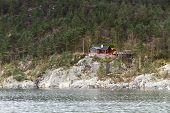 image of scant  - steep coast in norway with forest  - JPG