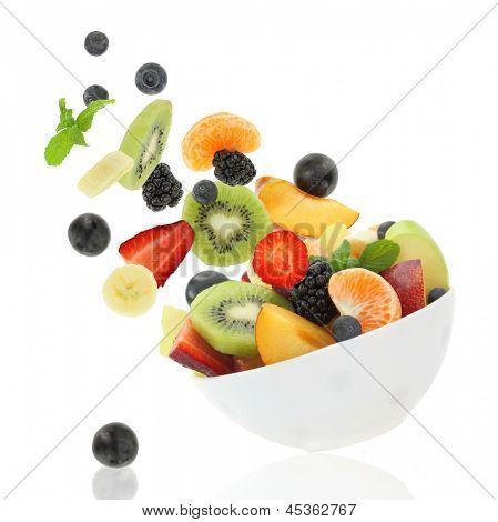 Постер, плакат: Свежие фрукты выходит из миски, холст на подрамнике
