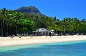 stock photo of waikiki  - A scene of Waikiki Beach with a deep blue sky above and blue ocean below - JPG