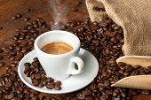 picture of hot coffee  - coffee cup with burlap sack of coffee beans and scoop - JPG