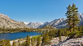 stock photo of arrowheads  - Pristine Mountain Lake in the Sierra Nevada California USA - JPG