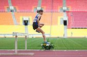 MOSCOW - JUN 11: The athlete will land after a jump on International athletic competition Moscow Cha