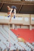 MOSCOW - JUN 11: Pole vaulter goes over bar at Grand Sports Arena of Luzhniki OCduring International