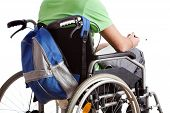 pic of wheelchair  - Student on wheelchair with backpack and notebook - JPG