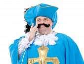 stock photo of courtier  - Cavalier gentleman in feathered cap and turquoise blue uniform of the cross with over a rotund fat belly isolated on white - JPG