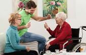 pic of independent woman  - Elder disabled person has a family visit - JPG