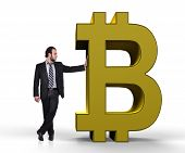 image of bitcoin  - businessman holding golden symbol of bitcoin on a white background - JPG