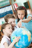 image of intercourse  - Friendly classmates help to each other to find something at the terrestrial globe - JPG