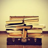 picture of bookworm  - a pile of books in an old suitcase with a retro effect - JPG