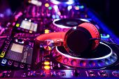 foto of mixer  - Dj mixer with headphones at a nightclub - JPG