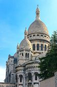 stock photo of sacred heart jesus  - View of the Basilica of the Sacred Heart of Jesus at the butte Montmartre of Paris evening - JPG