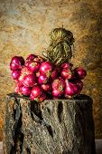 foto of red shallot  - Still Life With Shallots red onions on the timber.