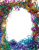 image of mardi gras mask  - A border made of a gold purple and green mardi gras mask and blue green red gold and purple plastic beads - JPG