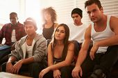 stock photo of gang  - Portrait Of Gang Members Sitting On Sofa In House - JPG