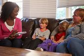 stock photo of neglect  - Social Worker Talking To Mother And Children At Home - JPG