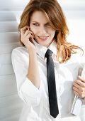 stock photo of button down shirt  - talkative woman in a white button down shirt with black tie - JPG