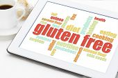 stock photo of buckwheat  - gluten free cooking word cloud on a digital tablet with a cup of coffee - JPG