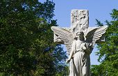 picture of bereavement  - Angel and Cross Statue standing in Cemetery - JPG